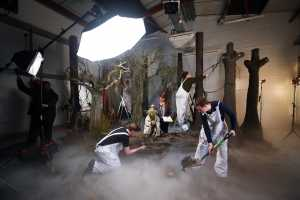 Madame Tussauds artist Katie Ashton puts the finishing touches to Yoda¹s figure, set designers work on an atmospheric recreation of his Dagobah swamp scene