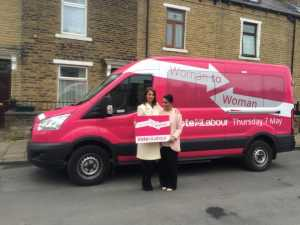 Gloria De Piero and Naz Shah stand outside the pink bus