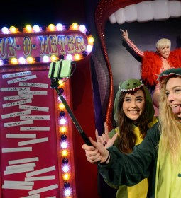 MILEY CYRUS SLIDES INTO MADAME TUSSAUDS LONDON ON A GIANT TONGUE!