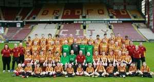 Bradord DFC players pose for a team photo .