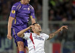 FLORENCE, ITALY - MAY 14: Stefan Savic of ACF Fiorentina battles for the ball with Aleix Vidal of FC Sevilla during the UEFA Europa League Semi Final match between ACF Fiorentina and FC Sevilla on May 14, 2015 in Florence, Italy.  (Photo by Gabriele Maltinti/Getty Images)