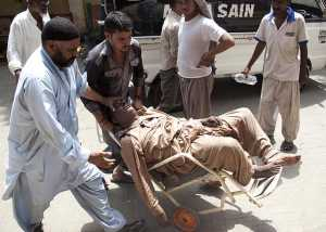 Image associated press people being rushed to hospital in karachi