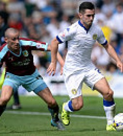 LEEDS, ENGLAND - AUGUST 08:  Lewis Cook (R) of Leeds United is challenged by David Jones of Burnley during the Sky Bet Championship match between Leeds United and Burnley at Elland Road on August 8, 2015 in Leeds, England.  (Photo by Nigel Roddis/Getty Images)
