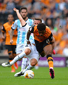 HULL, ENGLAND - AUGUST 08:  Chuba Akpom of Hull City battles for the ball with Jonathan Hogg of Huddersfield Town during the Sky Bet Championship match between Hull City and Huddersfield Town  at KC Stadium on August 8, 2015 in Hull, England.  (Photo by Tony Marshall/Getty Images)