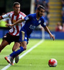 LEICESTER, ENGLAND - AUGUST 08:  Riyad Mahrez of Leicester City is challenged by Jack Rodwell of Sunderland during the Barclays Premier League match between Leicester City and Sunderland at the King Power Stadium on August 8, 2015 in Leicester, England.  (Photo by Ross Kinnaird/Getty Images)