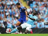 MANCHESTER, ENGLAND - AUGUST 16: Eden Hazard of Chelsea is tackled by Bacary Sagna of Manchester City during the Barclays Premier League match between Manchester City and Chelsea at the Etihad Stadium on August 16, 2015 in Manchester, England.  (Photo by Alex Livesey/Getty Images) *** Local Caption *** Eden Hazard; Bacary Sagna
