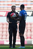 LONDON, ENGLAND - AUGUST 22: Callum Wilson (R)of Bournemouth holds the match ball away from Manager Eddie Howe (L) because of his hat trick after the Barclays Premier League match between West Ham United and A.F.C. Bournemouth at the Boleyn Ground on August 22, 2015 in London, England.  (Photo by Charlie Crowhurst/Getty Images) *** Local Caption *** Callum Wilson; Eddie Howe