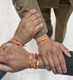 Pictured:Rakhi wristbands on the wrists of Army, Royal Navy and Royal Air Force personnel.