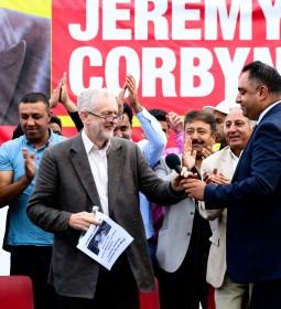 Imran passing Corbyn mike