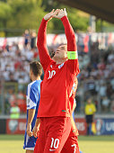 SAN MARINO, ITALY - SEPTEMBER 05:  Wayne Rooney of England celebrates after scoring the opening goal during the UEFA EURO 2016 Qualifier between San Marino and England at Stadio Olimpico on September 5, 2015 in San Marino, Italy.  (Photo by Marco Luzzani/Getty Images)