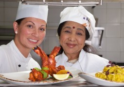 Bollywood singing star Asha Bhosle attends the launch of new restaurant