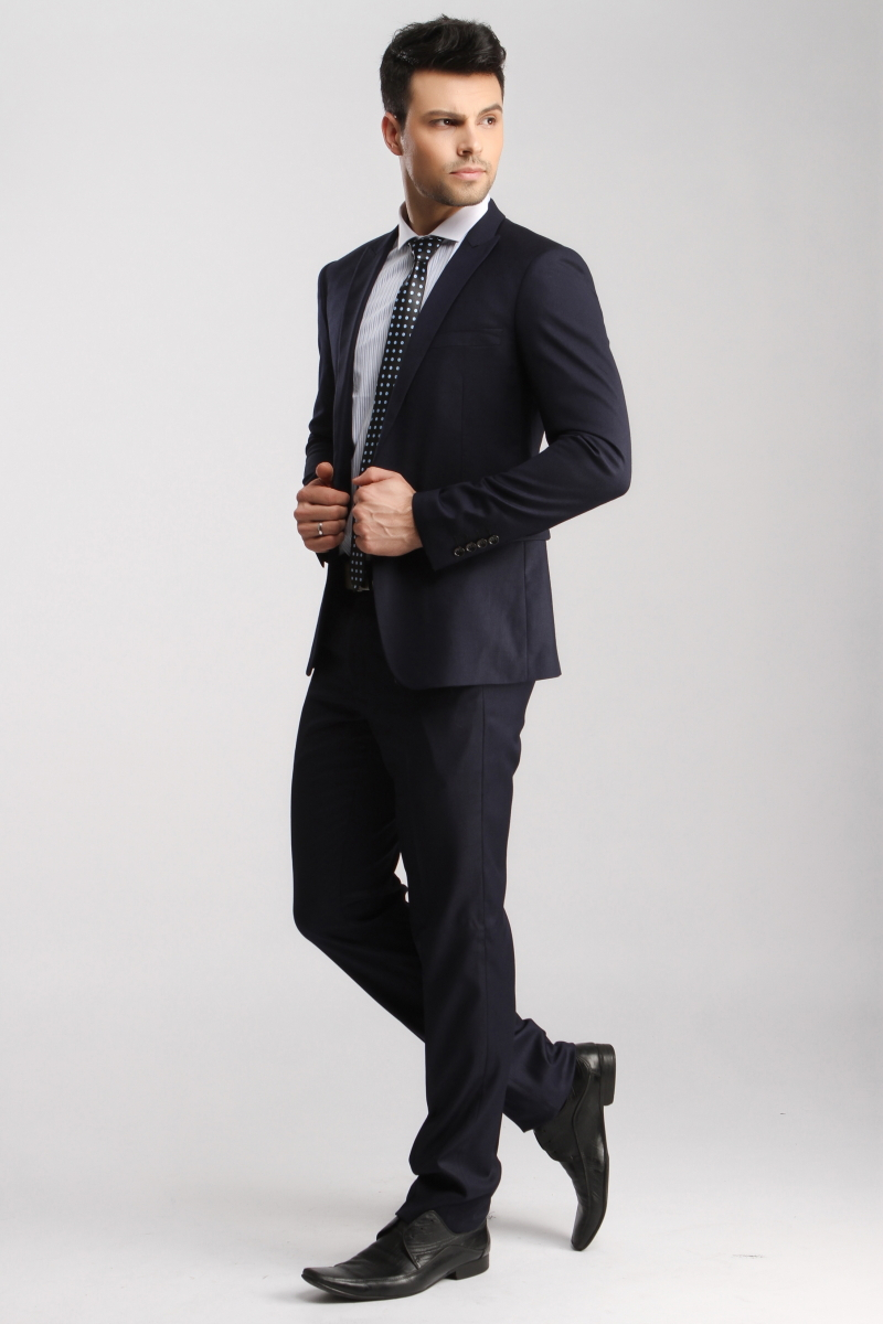 Business formal attire is an upgrade from your normal day-to-day professional outfits. Dressy evening events and award ceremonies may call for business formal dress. Men wear a dark colored suit.