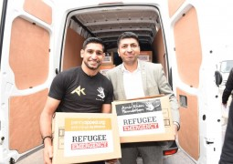 Amir Khan is on hand to help refugees in Greece