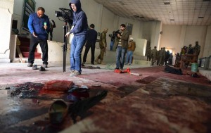 Aftermath of Pakistani soldiers and media gathering in a ceremony hall at the army-run school after an attack by militants in Peshawar last December.