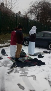Students of Mirfield Grammar, praying in the snow, because it is believed the school refuses to provide suitable praying space indoors