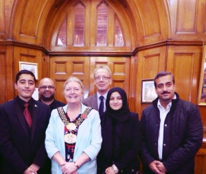 From L to R Front row: Ahmed Nawaz, a young boy who survived a Taliban shooting in Pakistan, by playing dead, Lord Mayor Joanne Dodds, Facilitator Zeynab Ahmed, Ahmed's dad. Back: Family friend of Ahmed's, Bradford Council Leader David Green
