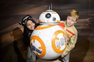 Young fans are delighted to meet the cheerful little droid