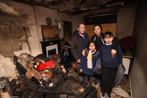 The family in the remains of their living room