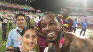 Asian Sunday Correspondent Halima Khan celebrating with Chris Gayle and the West Indies Team