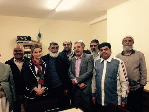 Jo Cox with members of the Muslim community at the Al Hikmah, centre, following a game of carrom board