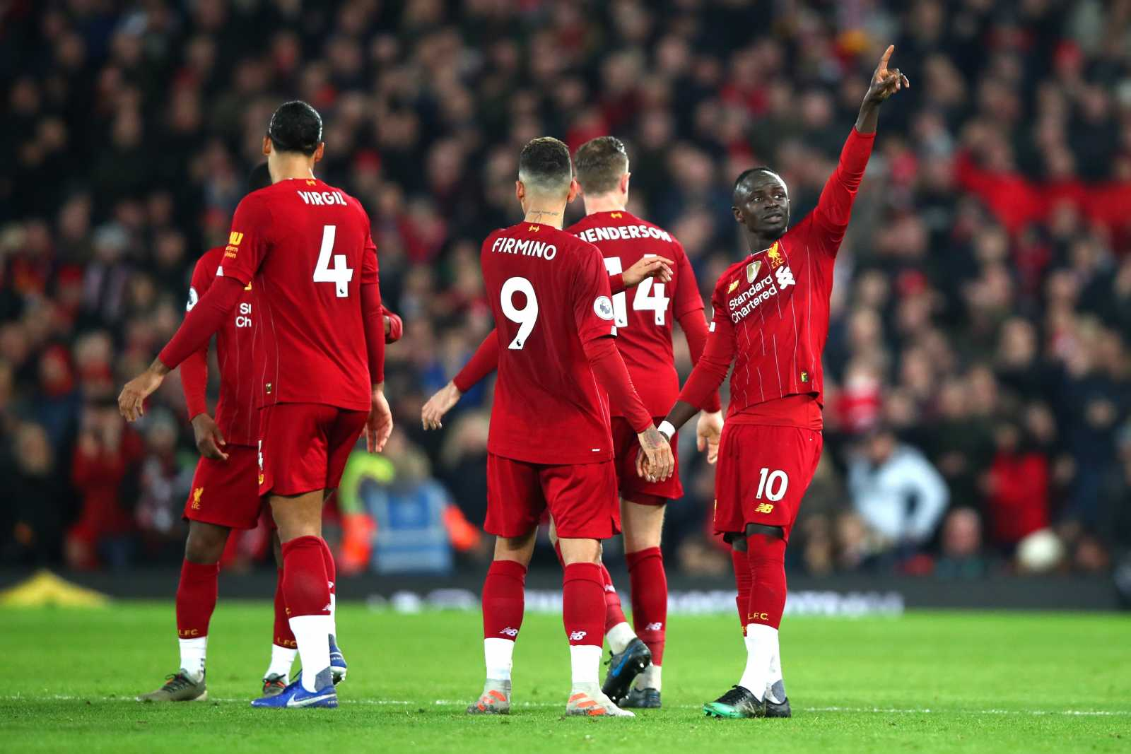 Sadio Mane celebrates with his Liverpool team mates, after scoring the winning goal in the 1-0 win over Wolves. which now sees Liverpool 13 points clear at the top of the Premier League